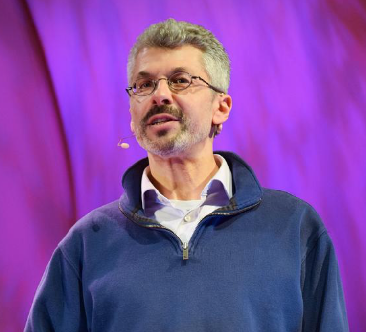 Photo of Faculty Jonathan Marks speaking on a stage.